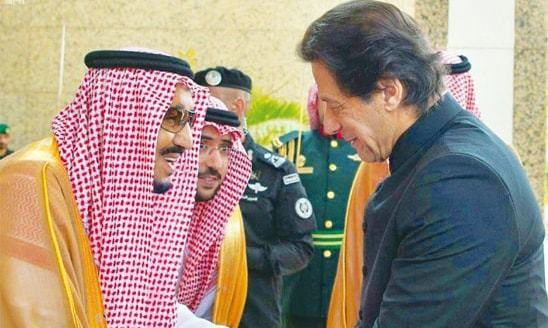 Prime Minister Imran Khan shakes hands with King Salman bin Abdul Aziz. —APP/File photo