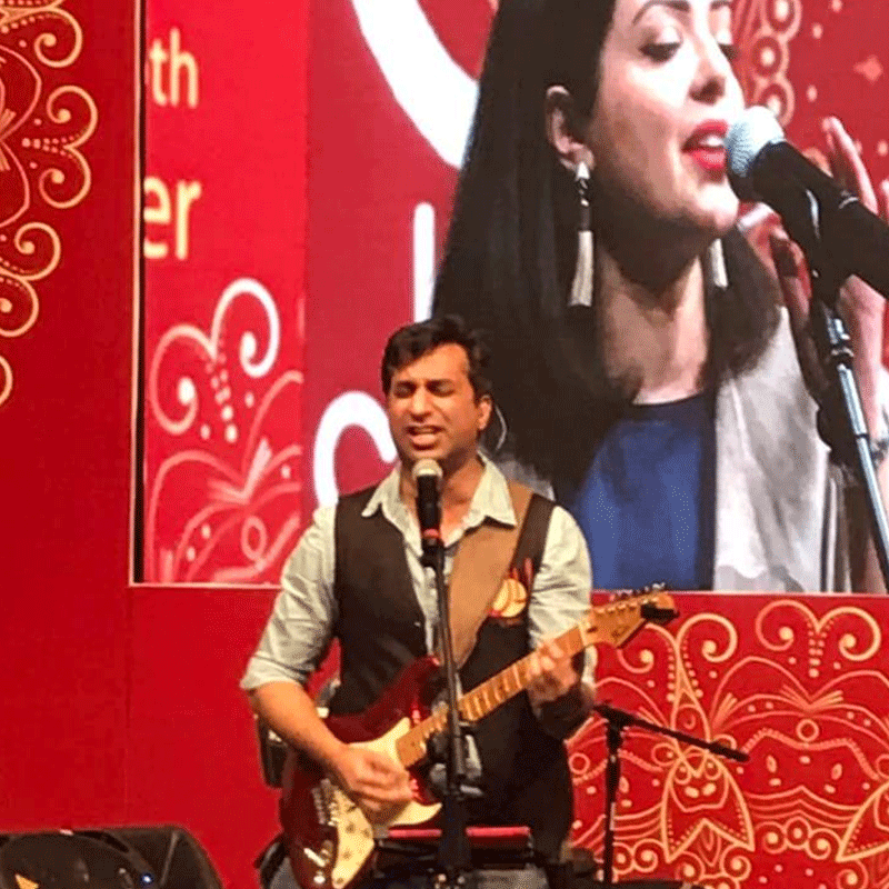 Rahman performing on stage at the Faiz International Festival.
