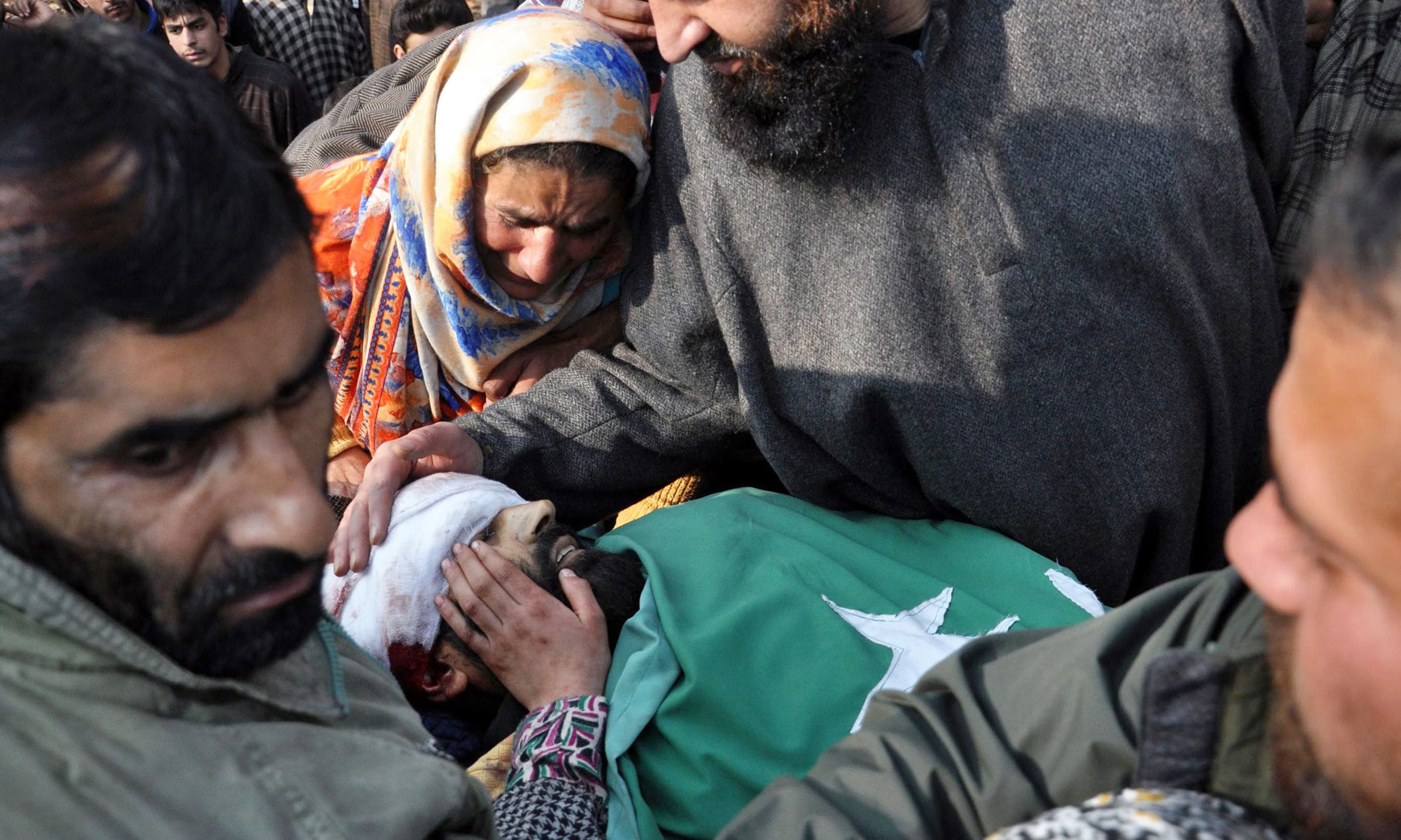 Relatives mourn over the body of Tehreek-e-Hurriyat leader Hafizullah Mir in Kashmir's Anantnag district. —AP