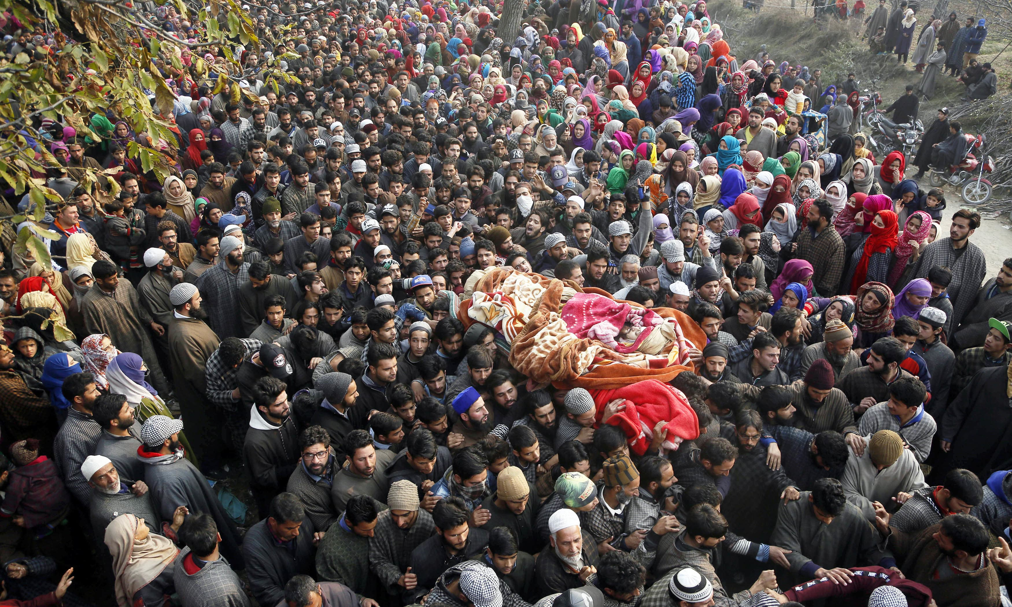 Villagers carry the body of Abid chopan during his funeral at Shopian, south of Srinagar. —AP