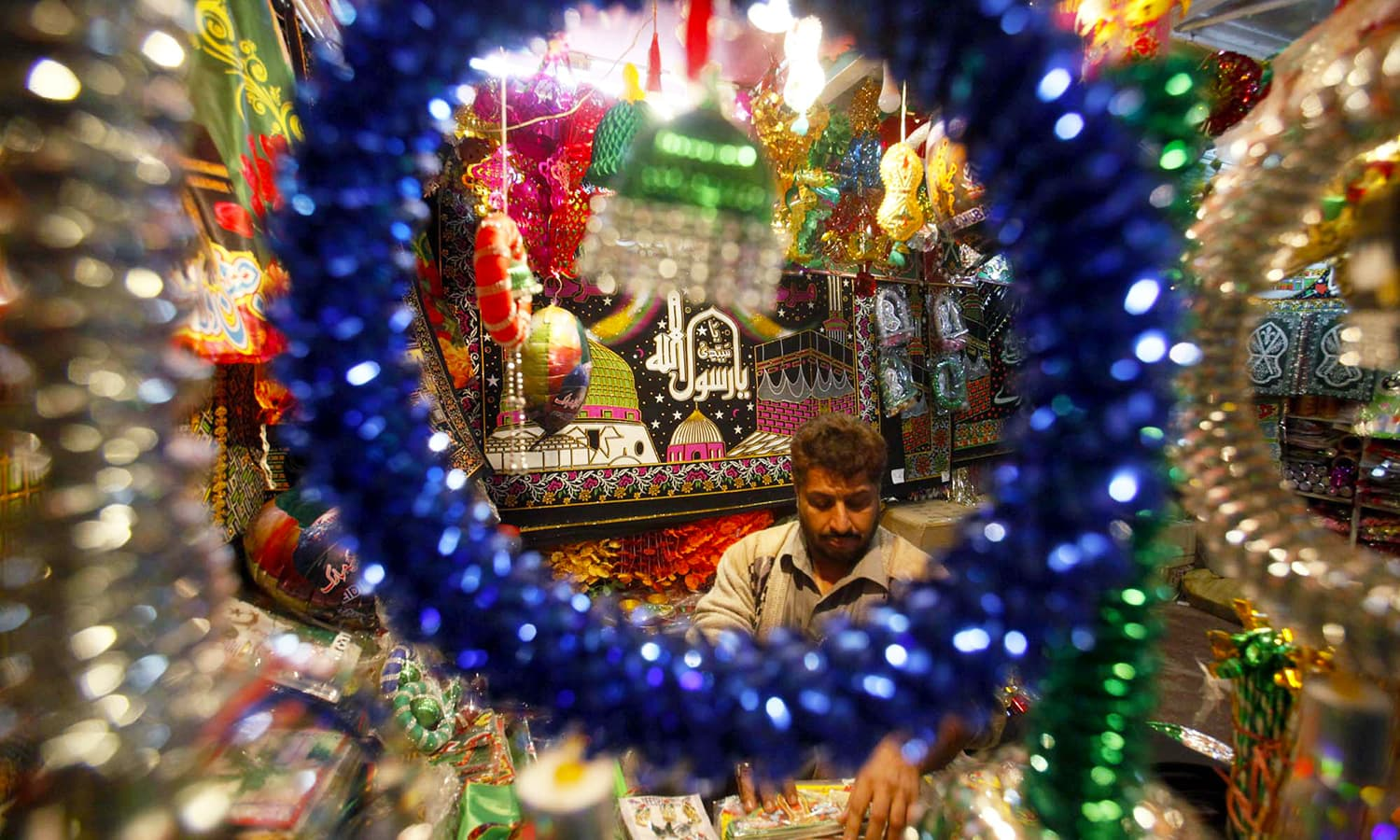 Buntings, flags, badges and souvenirs being sold at roadside stalls at Ghanta Ghar Bazar in Peshawar. — APP
