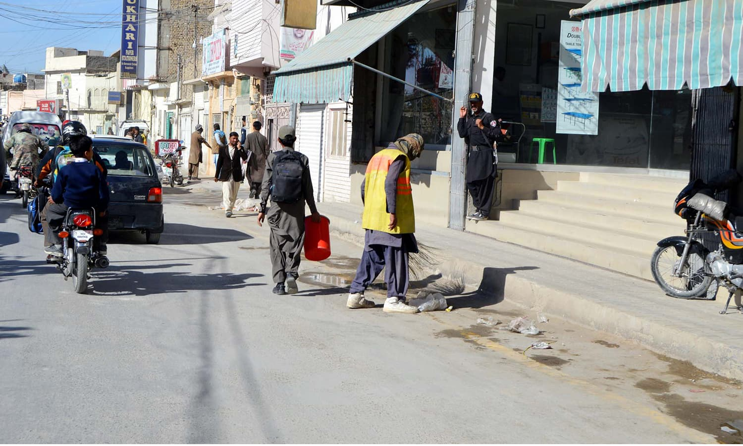 Workers of Municipal Corporation clean streets during a cleaning drive at TNT Chowk in Quetta ahead of Eid Miladin Nabi. — APP