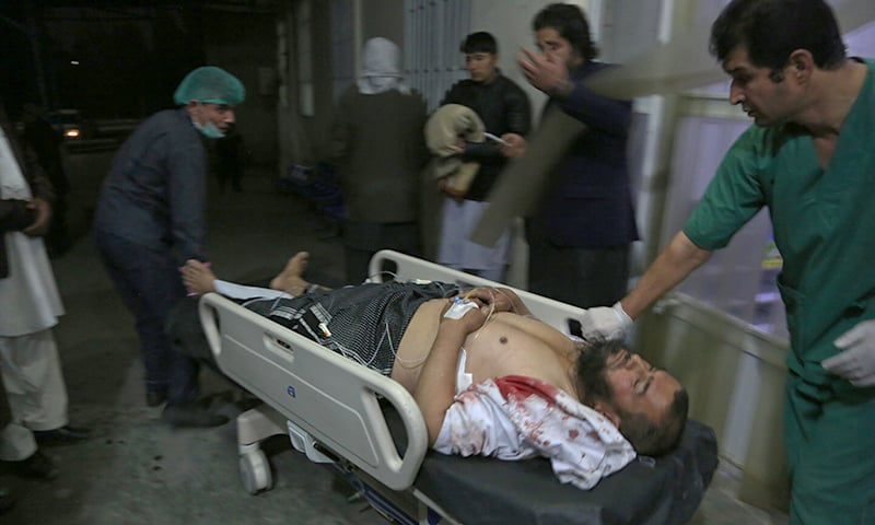 An injured man is brought into a hospital in Kabul. —AP