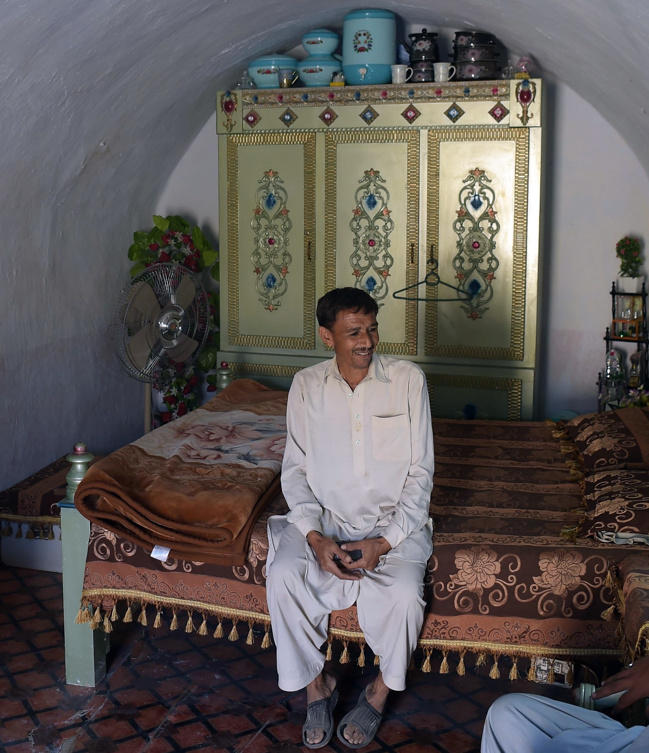 Thousands of villagers are choosing to hunker down in caves northwest of Islamabad, snapping up the hobbit-like homes amid a nationwide housing shortage. —AFP