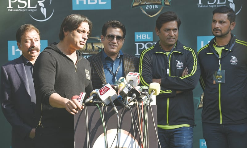 FLANKED by Lahore Qalandars' owner Rana Fawad (L), CEO Rana Atif (third L) and head coach Aaqib Javed (second R), the franchise's bowling mentor Shoaib Akhtar interacts with media.—White Star