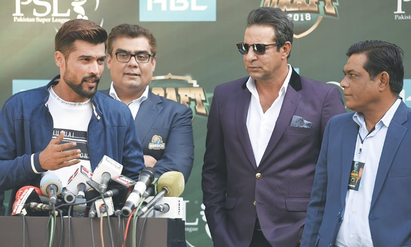 WATCHED by Karachi Kings' owner Salman Iqbal (second L) and former Pakistan captains Wasim Akram (second R) and Rashid Latif, fast bowler Mohammad Amir speaks to media.—White Star