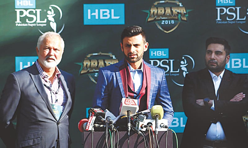SHOAIB Malik, the captain of sixth team, speaks to journalists as the manager of the team Nadeem Khan (L) watches. —Courtesy PCB