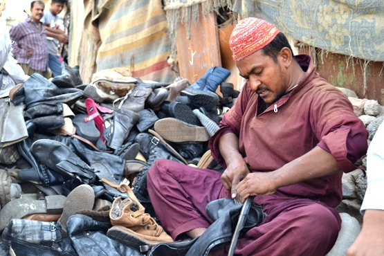Akbar has been working as a shoe sorter in Wahid Colony for the past decade. –All photos by Fizza Qureshi