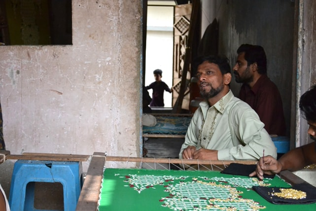 Majed owns an embroidery workshop in Moosa Colony and employs eight people.