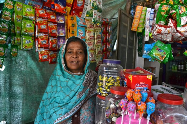 Ayesha and her son run a small shop in Mujahid Colony.