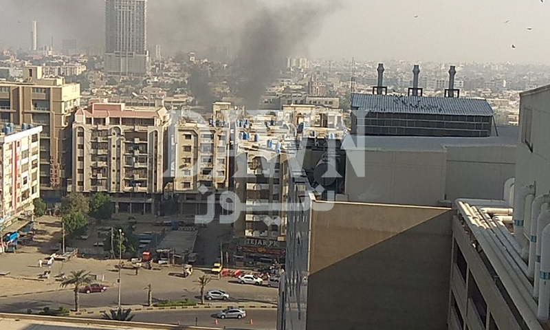 Smoke rises from the area near the Chinese Consulate in Karachi. — DawnNewsTV
