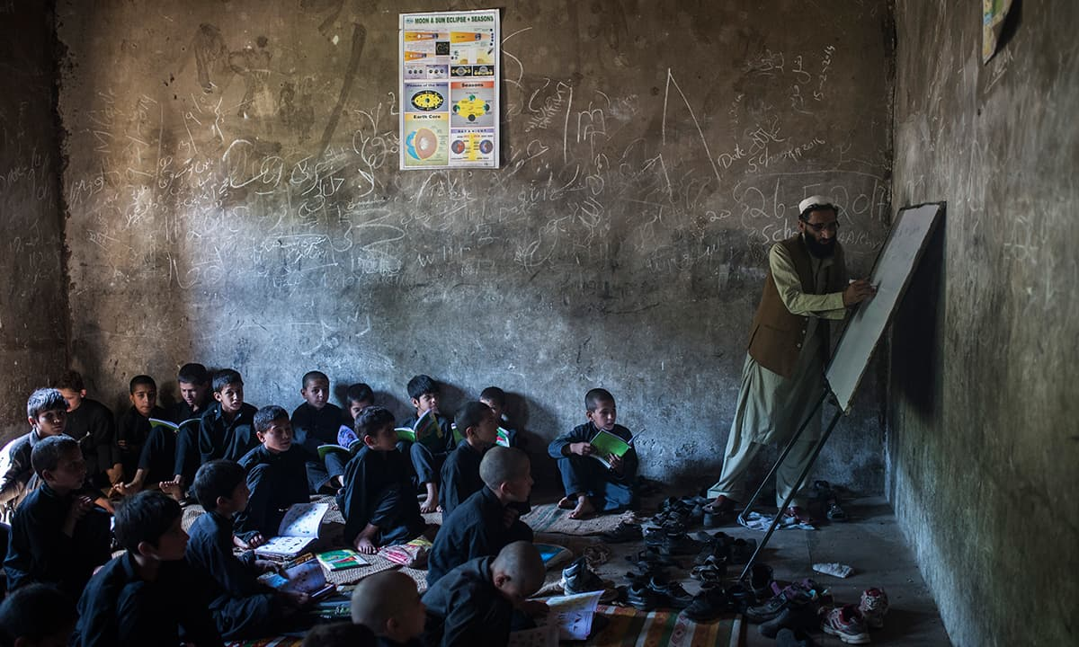 The main building of the Government Primary School Bankad, South Kohistan, lies three hours from the main road. It was damaged during the 2005 earthquake, leaving only one building usable. Students study in corridors outside the building and sit on the ground