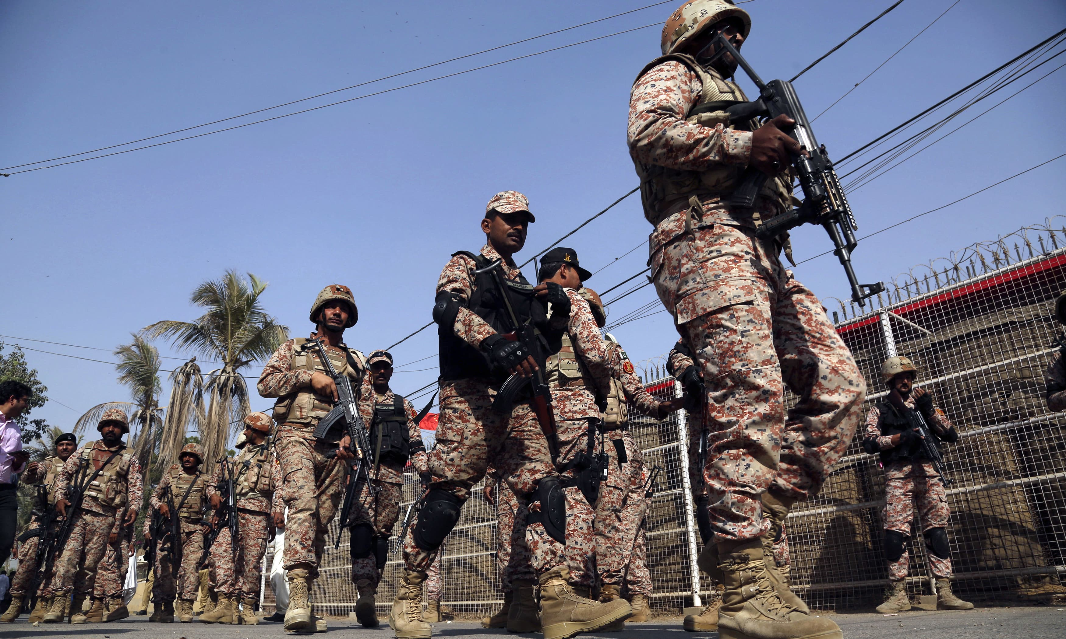Rangers personnel move in the compound of Chinese Consulate in Karachi. —AP