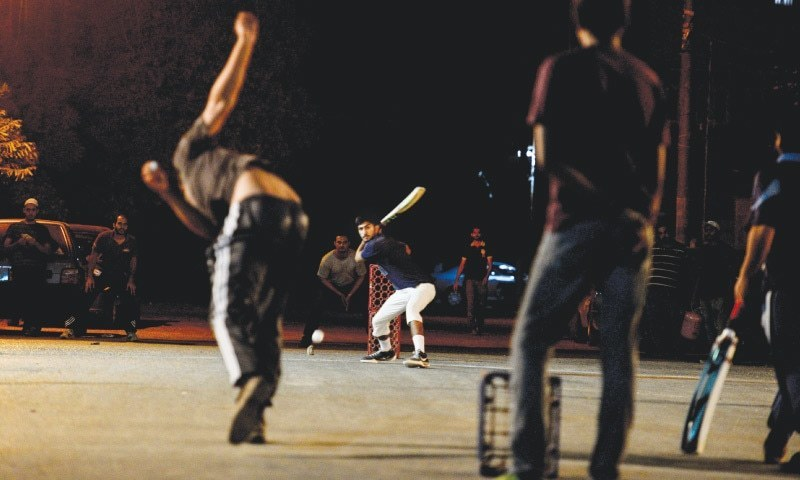 Youngsters playing cricket on the streets of Karachi. —Dawn archives