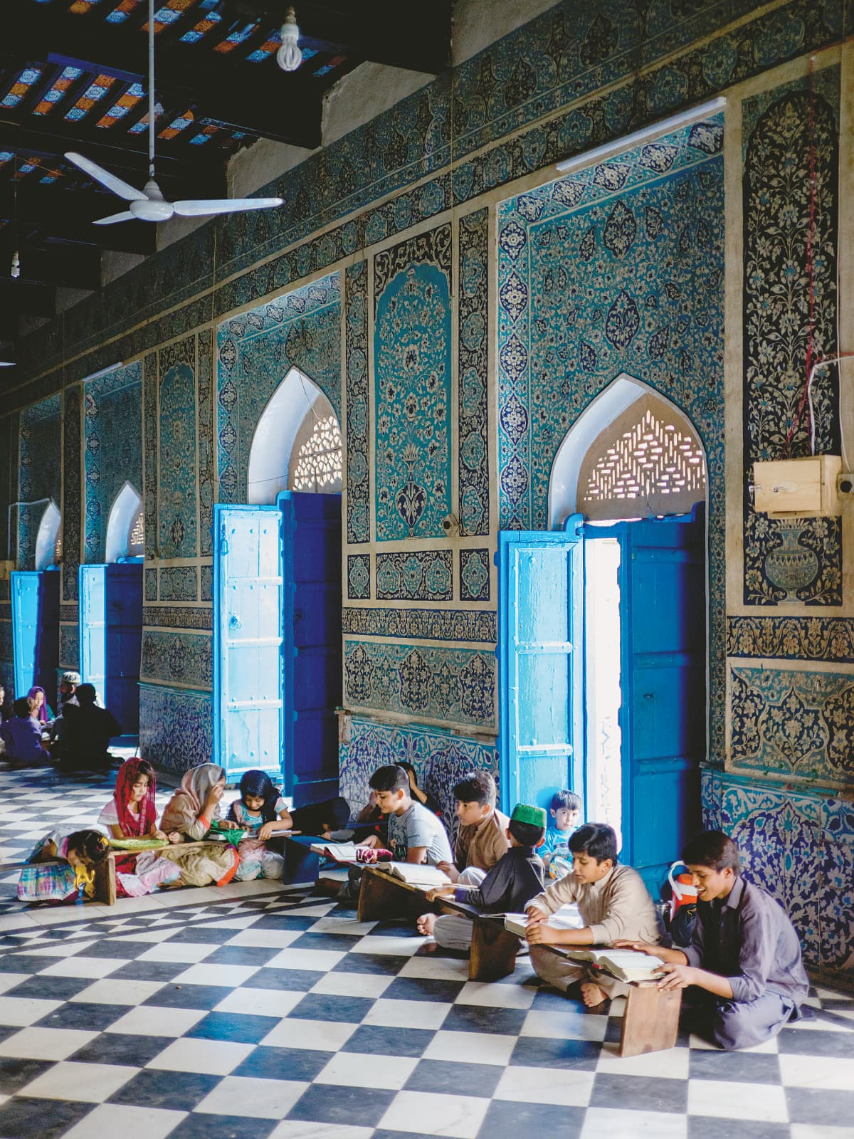 Children reciting the Quran in the shrine's mosque on a Thursday