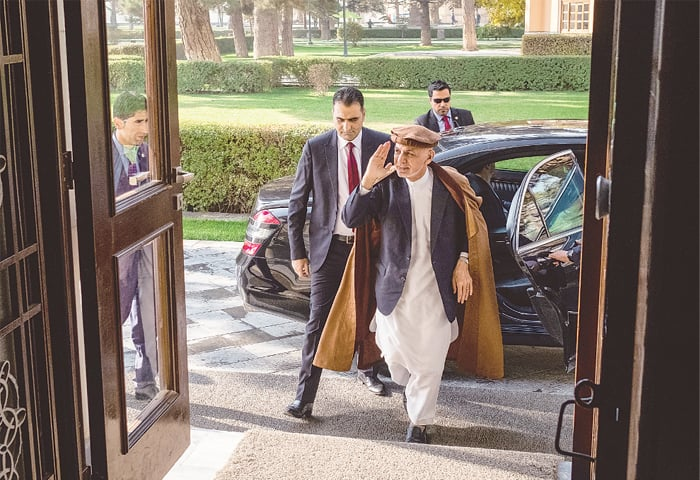 Afghan President Ashraf Ghani (centre) arrives at the Presidential Palace in Kabul on Nov 1 | Bloomberg