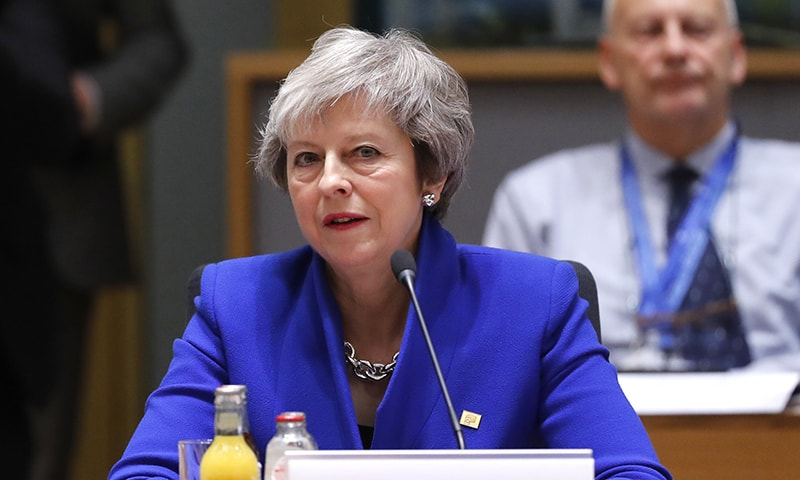 British Prime Minister Theresa May attends a round table meeting at an EU summit in Brussels, Sunday, Nov. 25, 2018. — AP