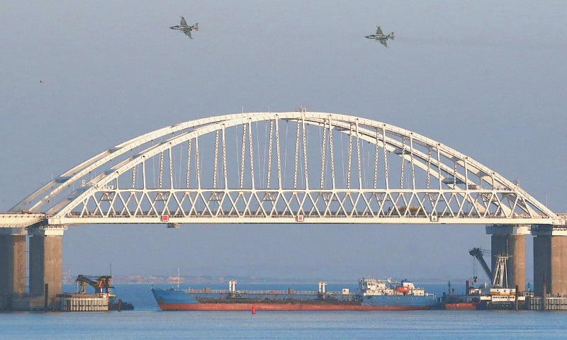 Russian fighters fly over a bridge connecting the Russian mainland with the Crimean peninsula after three Ukrainian navy vessels were stopped from entering the Sea of Azov.—Reuters