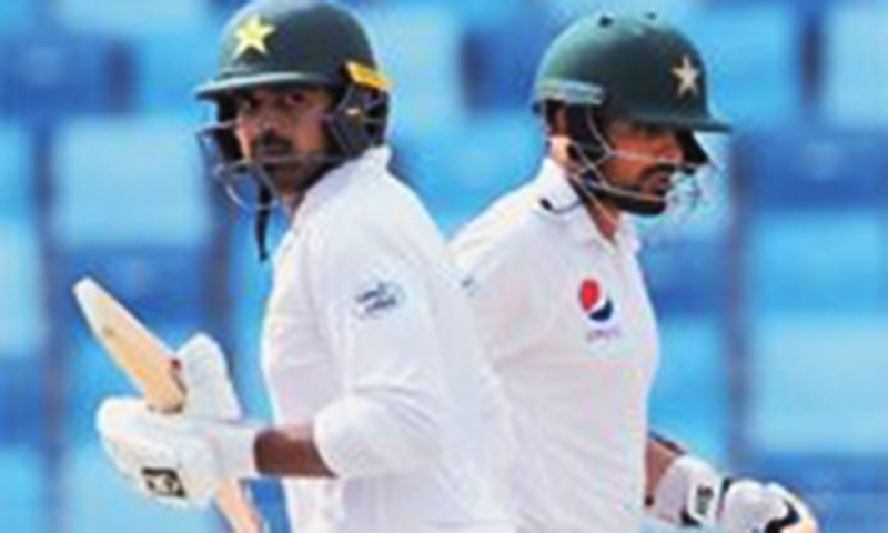 Pakistani batsmen Haris Sohail (L) and Babar Azam run between the wickets during the second Test against New Zealand at the Dubai International Stadium on Sunday.— AFP