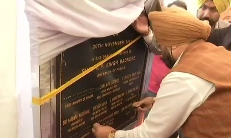 Punjab minister Sukhjinder Singh Randhawa used tape to black out his own and other Punjab ministers' names on the foundation stone. — Photo courtesy ANI