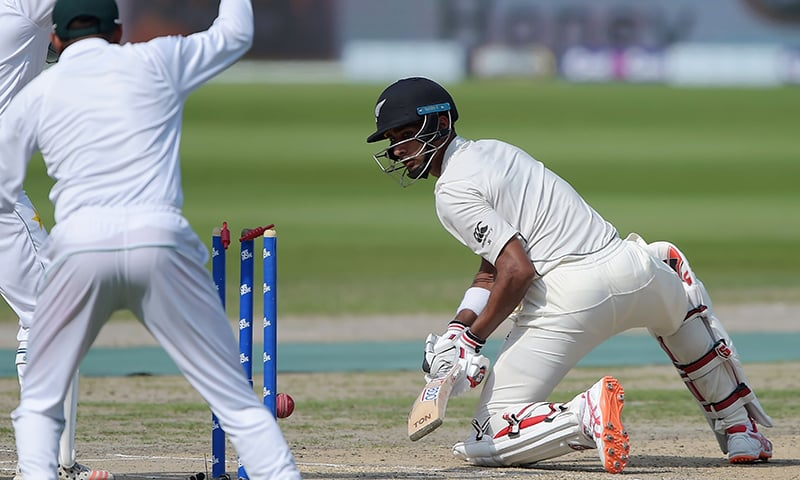New Zealand batsman Jeet Raval watches as he is bowled out by Yasir Shah during the third day of the second Test cricket match between Pakistan and New Zealand at the Dubai International Cricket Stadium in Dubai on November 26, 2018. — AFP