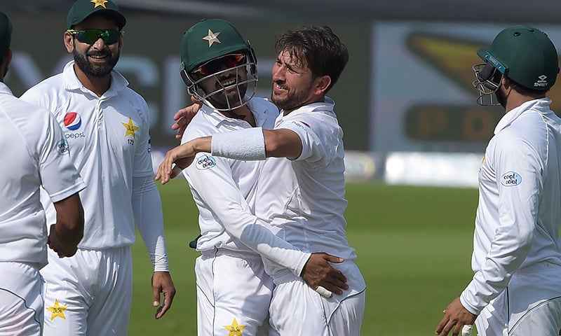 Pakistani spinner Yasir Shah celebrates with teammates after taking the wicket of New Zealand batsman Henry Nicholls during the third day of the second Test cricket match between Pakistan and New Zealand at the Dubai International Cricket Stadium in Dubai on November 26, 2018. — AFP