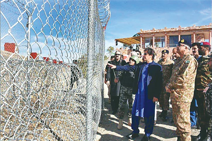 NORTH WAZIRISTAN: Prime Minister Imran Khan visiting the Ghulam Khan Border terminal on Monday to inspect fencing along the border with Afghanistan. Army Chief Gen Qamar Javed Bajwa is also seen.—APP