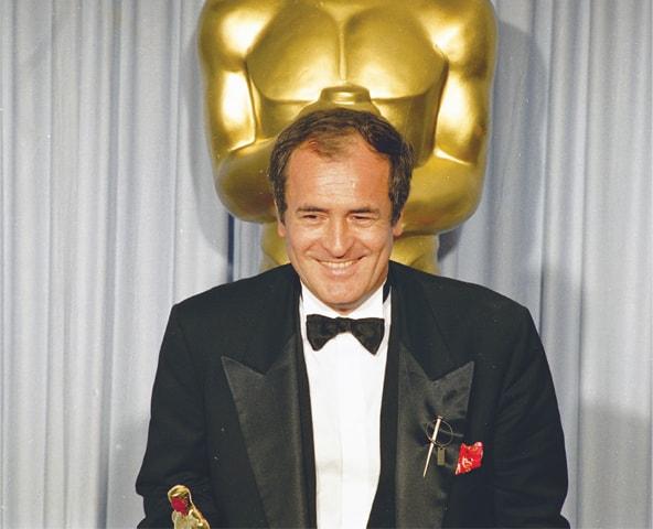 Bernardo Bertolucci with his best director Oscar award for The Last Emperor in 1988.—AP