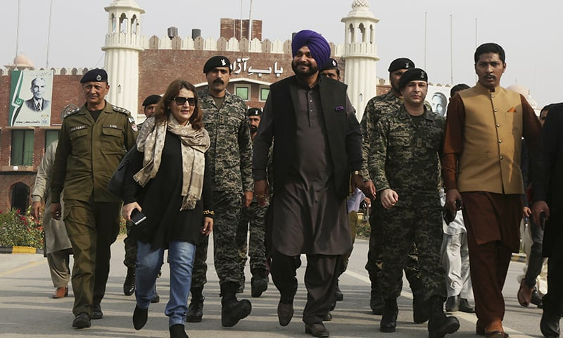 Former Indian cricketer-turned-politician Navjot Singh Sidhu, centre, arrives at the Pakistani border post Wagah near Lahore on Tuesday. — AP