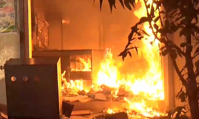 A shop is set on fire in Korangi's Mehran Town. — DawnNewsTV