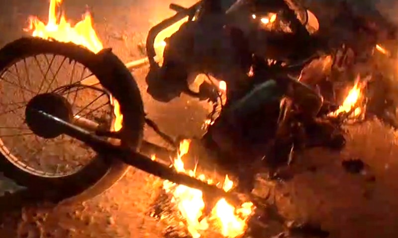 A motorcycle set on fire in Korangi. — DawnNewsTV