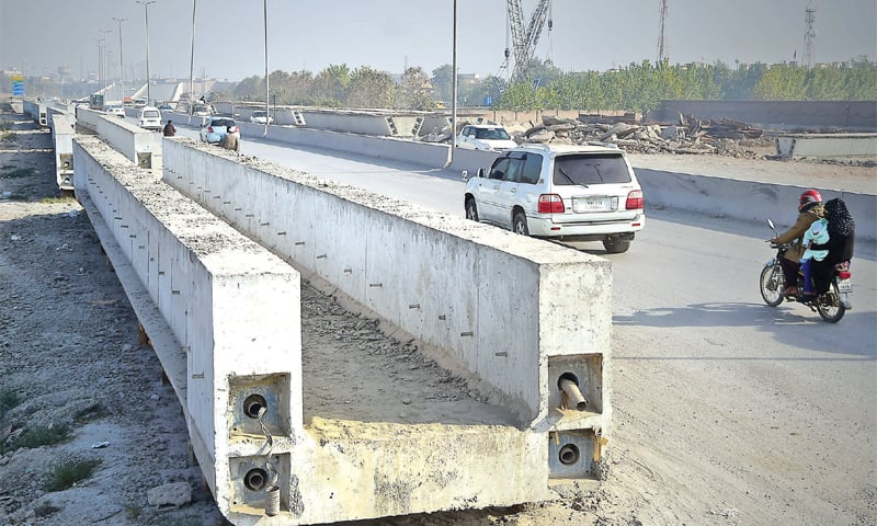Concrete girders meant for construction of elevated track for bicyclists and pedestrians have been dumped along Ring Road near Bacha Khan Chowk, Peshawar, after they were found faulty. — Photo by Abdul Majeed Goraya