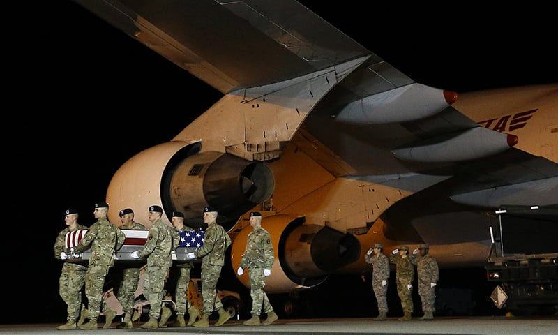 A US Army carry team moves a transfer case containing the remains of Sgt. Leandro A. Jasso, at Dover Air Force Base, Del. — AP