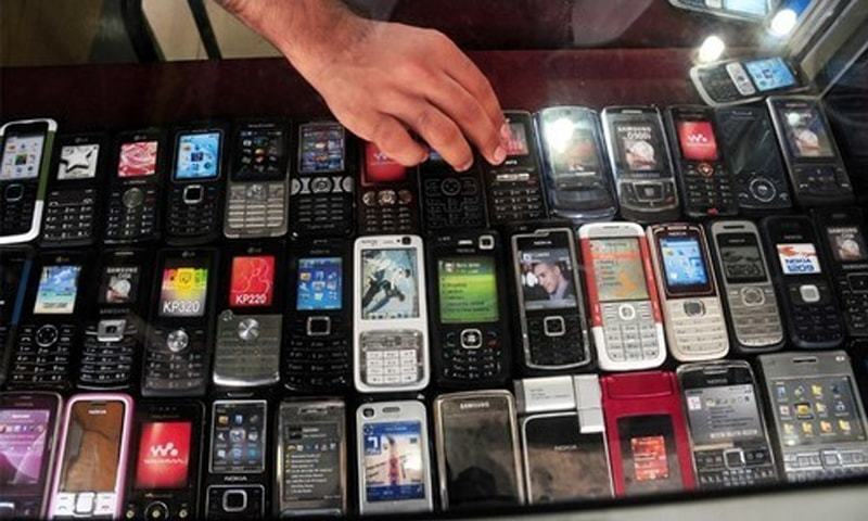 Phones on display at the mobile market on Abdullah Haroon Road.—White Star