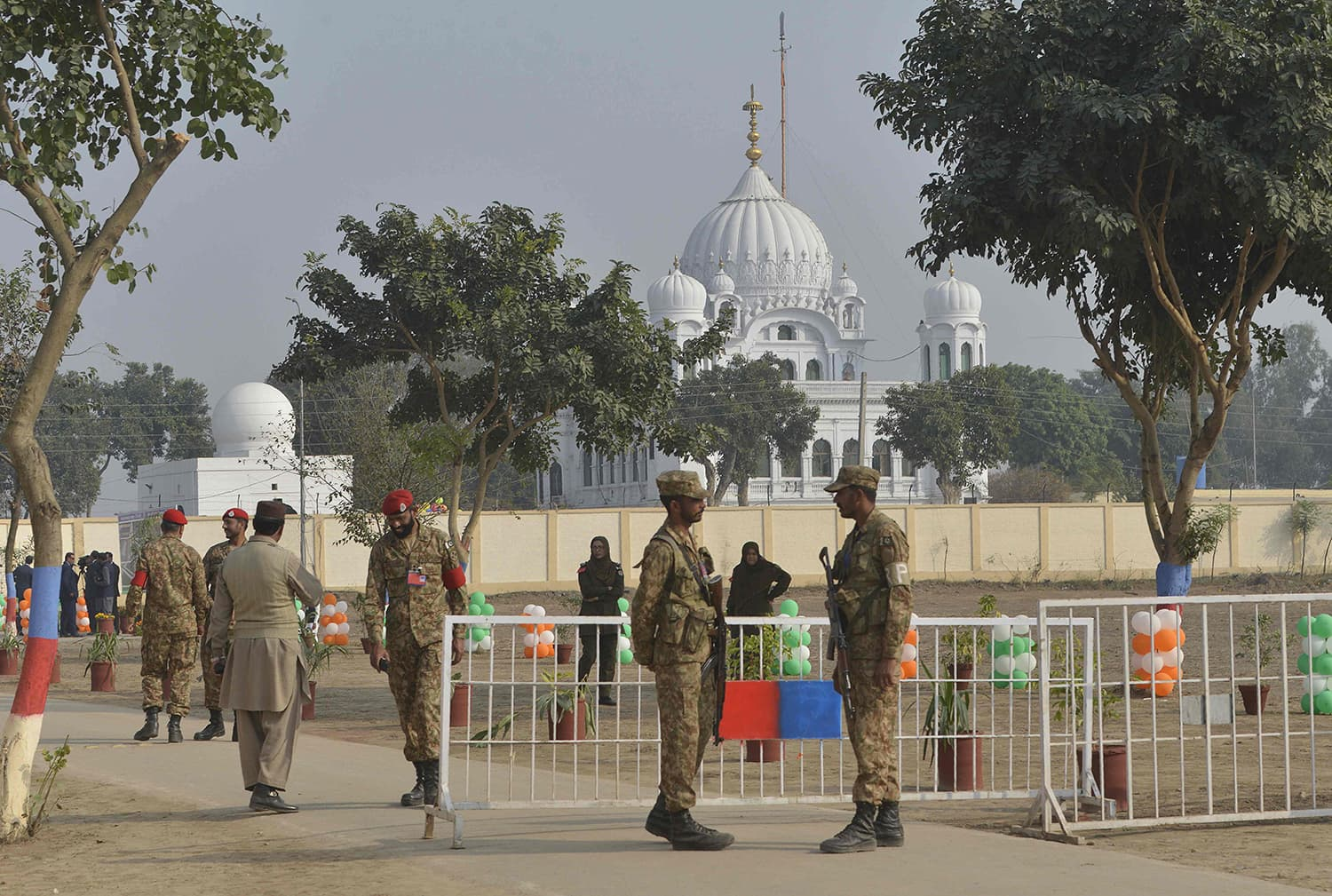 Pakistan Army soldiers gather in front of Kartarpur Gurdwara Sahib during the groundbreaking ceremony.—AFP
