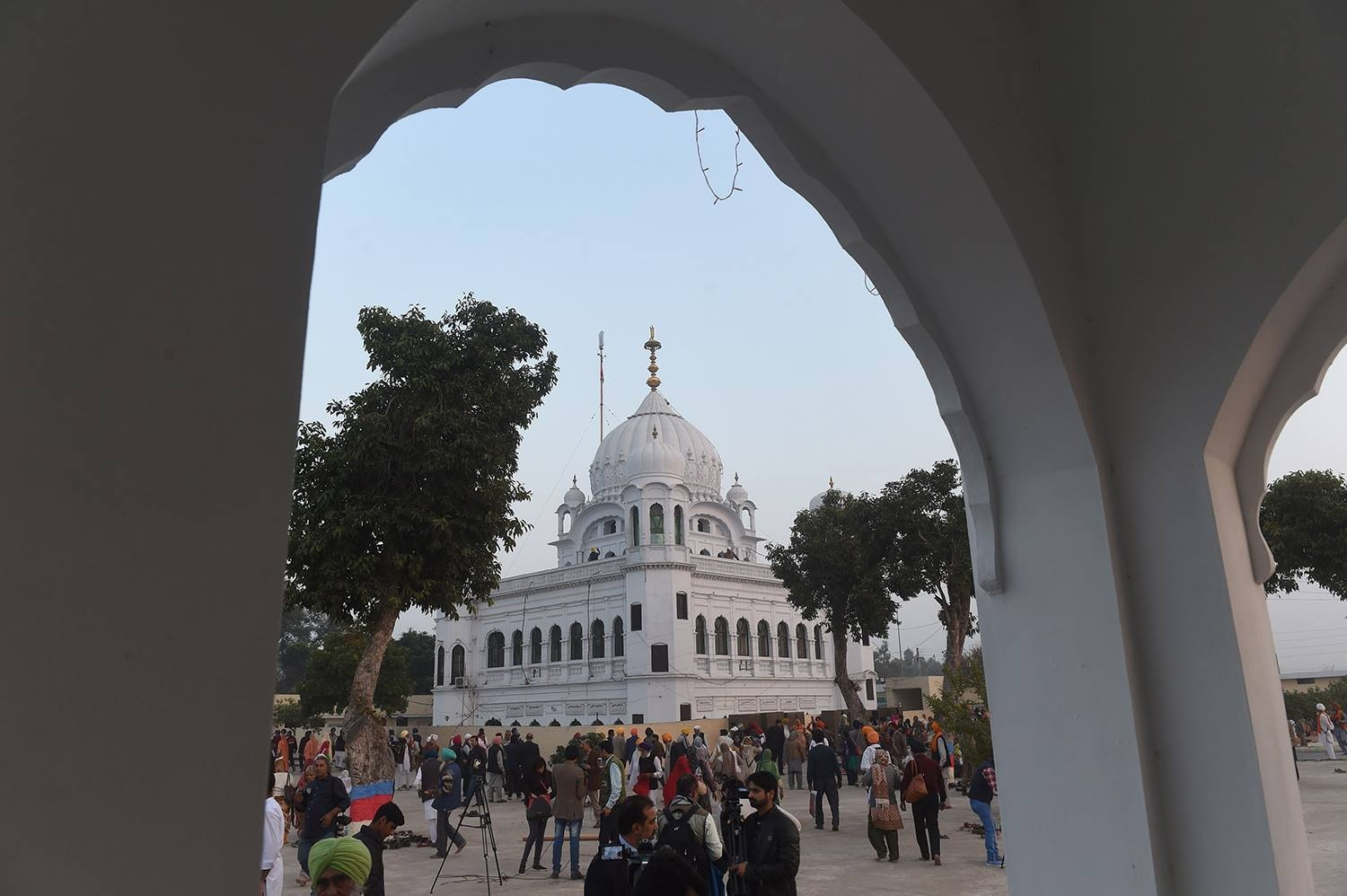 Sikh Pilgrims gather in front of Kartarpur Gurdwara Sahib before the groundbreaking ceremony. — AFP