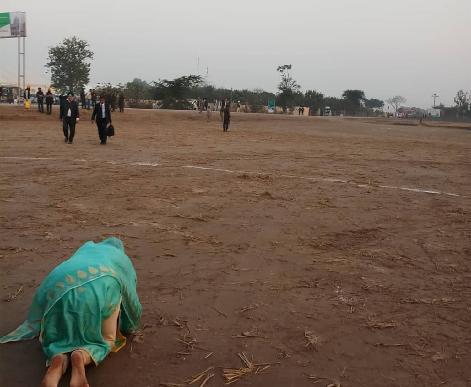 Indian Minister for Food Harsimrat Kaur prostrates herself on the soil in Kartarpur with the Gurdwara Darbar Sahib in view.─Photo courtesy Harsimrat Kaur Badal Twitter