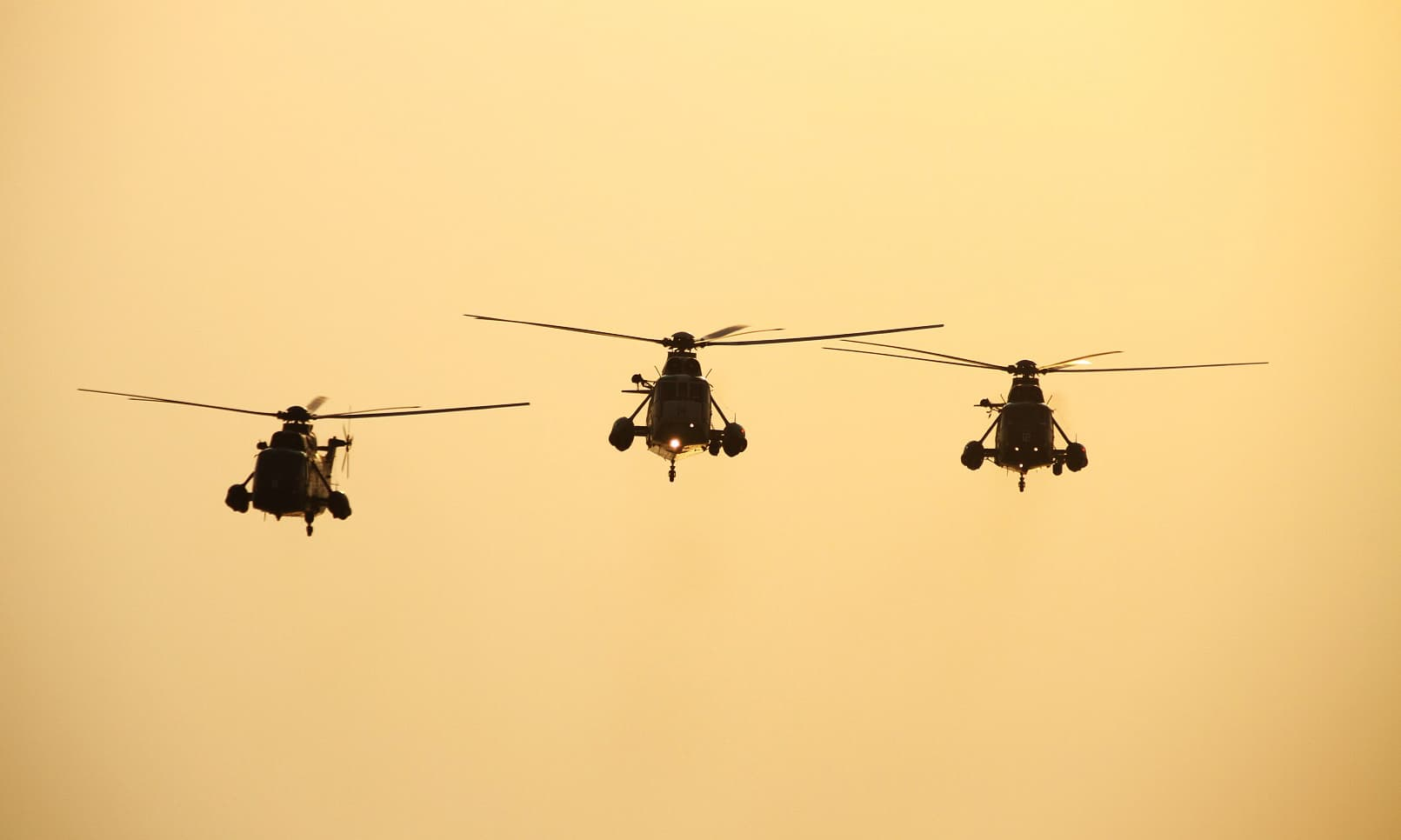 Navy's Sea King helicopters during a flypast at Karachi show held at Sea View. —ISPR