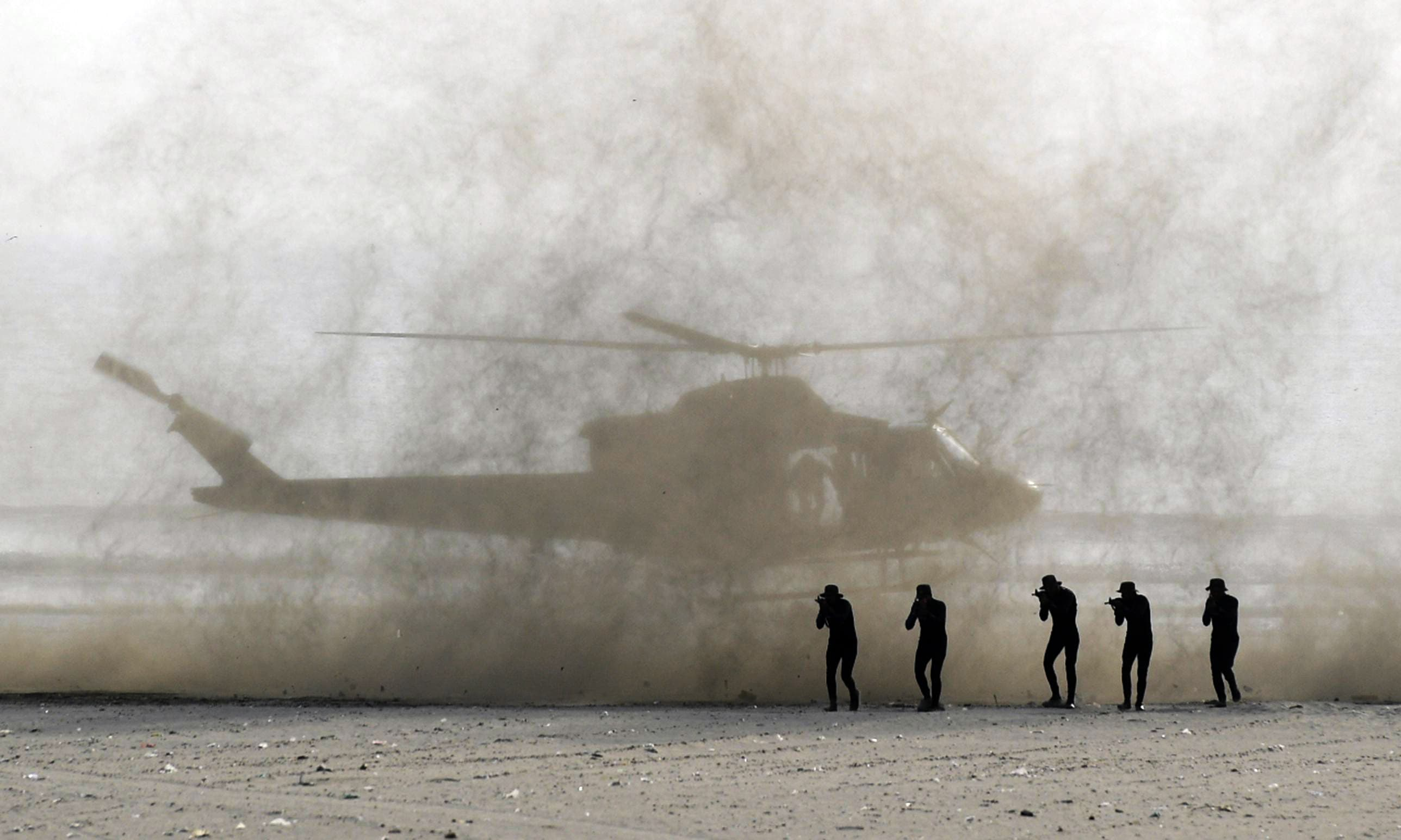 Military personnel take part in a drill as part of the 10th IDEAS expo in Karachi. —AFP