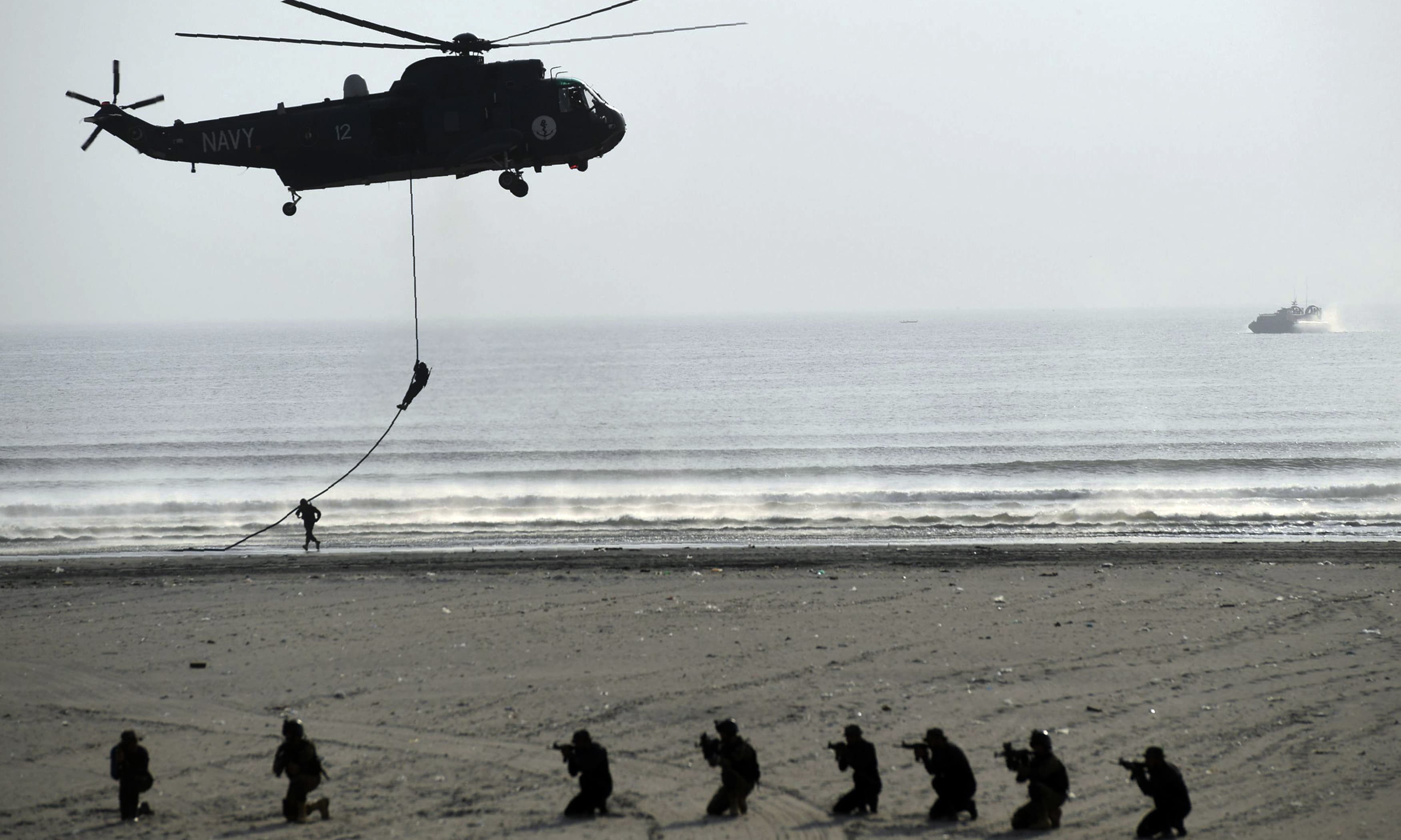 Military personnel take part in a drill during Karachi Show, part of IDEAS-2018. —AFP or licensors