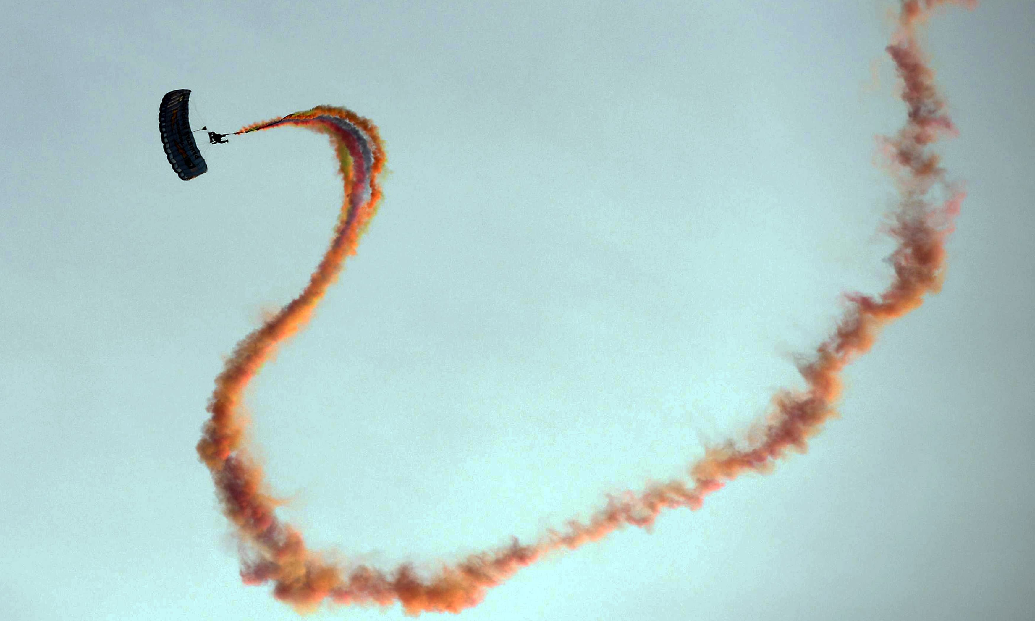 A paratrooper descends on his parachute. —AFP