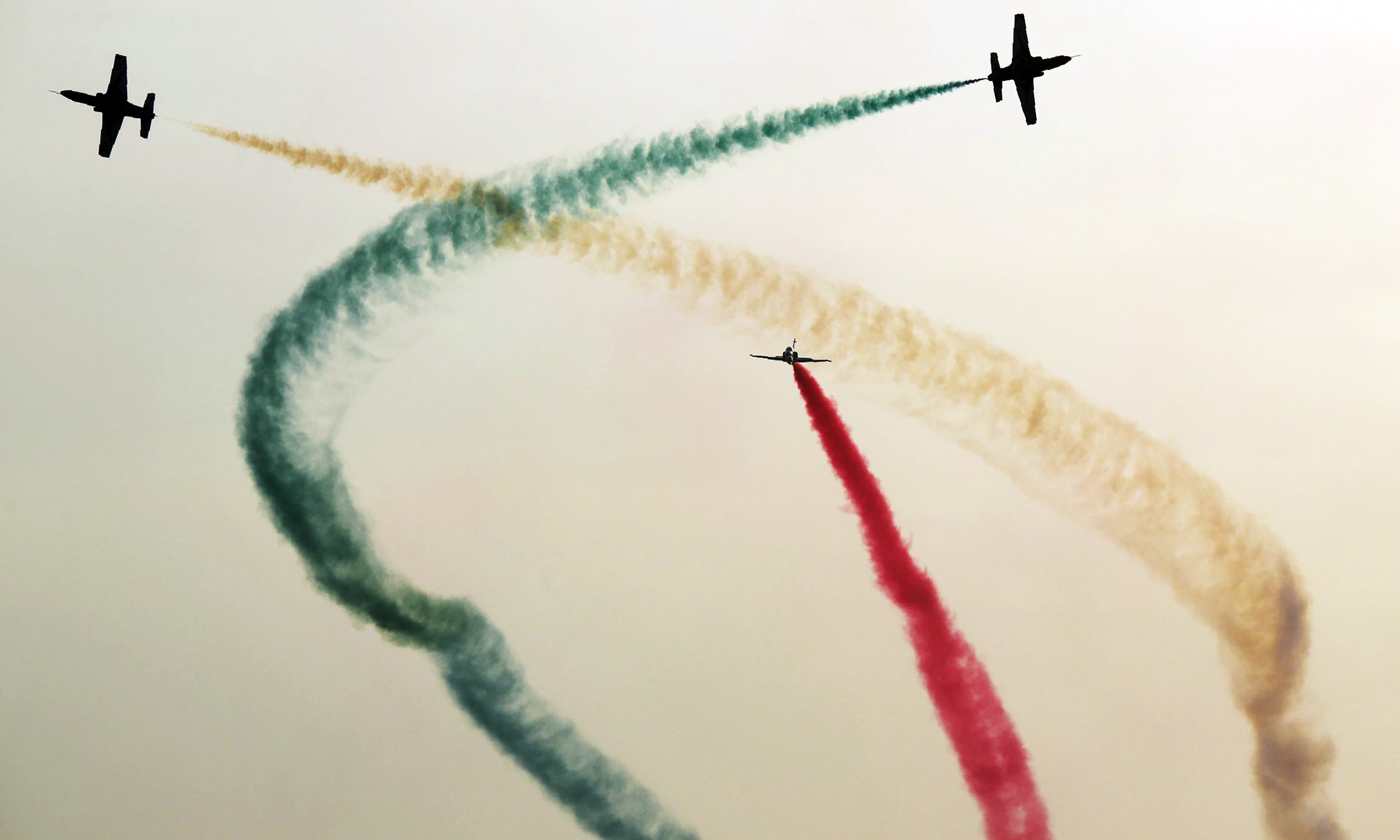 K-8 Karakorums of PAF's Sherdils aerobatics display team fly in formation over Sea View. —AFP