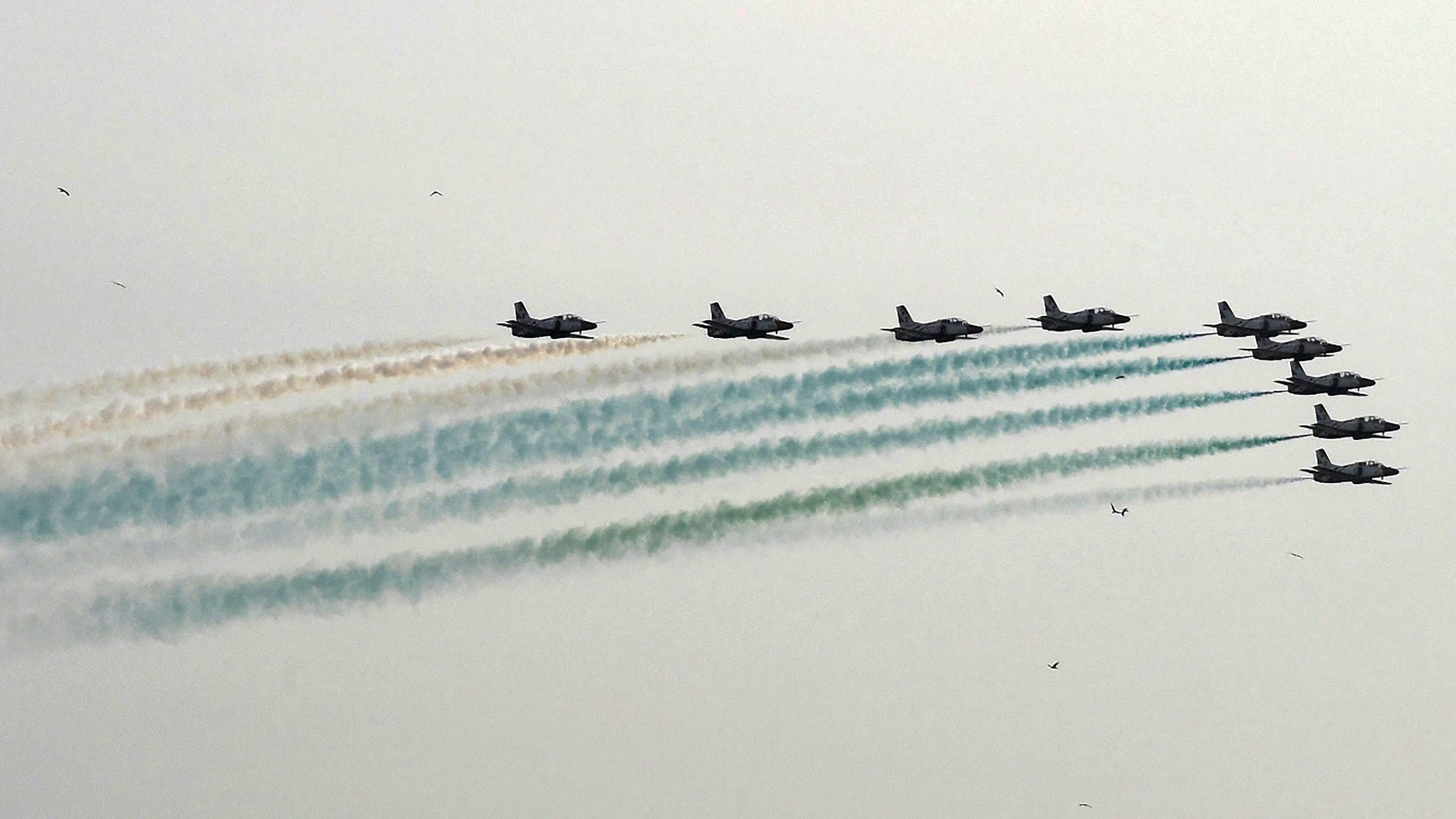 K-8 Karakorums of the Pakistan Air Force's Sherdils aerobatics display team fly in formation during the tenth International Defence Exhibition and Seminar (IDEAS) in Karachi on November 29, 2018. (Photo by ASIF HASSAN / AFP) — AFP or licensors