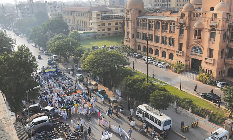 JI activists and traders hold a sit-in in front of the KMC building on Friday.—White Star