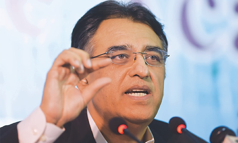 ASAD Umar says the rate was kept artificially overvalued in the past which hurt the economy.—AFP