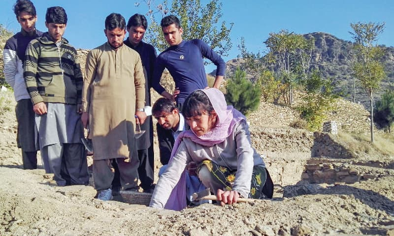 The Italian archaeologist teaches excavation techniques to students of Swat University at Bazira site. — Dawn photo