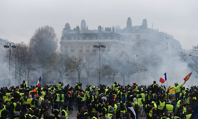 Demonstrators gather during a protest of Yellow Vests (Gilets jaunes) against rising oil prices and living costs. — AFP