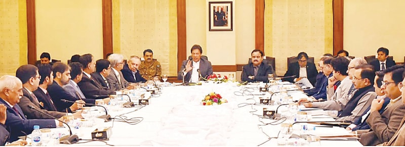 LAHORE: Prime Minister Imran Khan speaks to a delegation of the Lahore Chamber of Commerce on Saturday.—INP