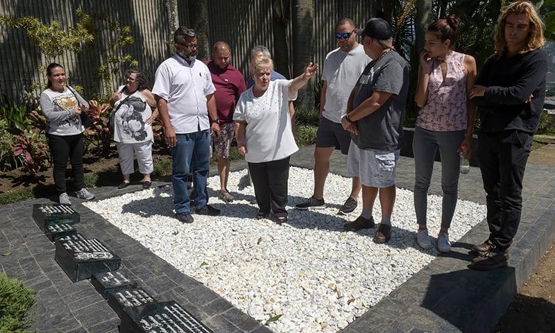 Pablo Escobar's sister Luz Maria Escobar (C), visits his tomb at the Montesacro cemetery in Medellin, Colombia. — AFP