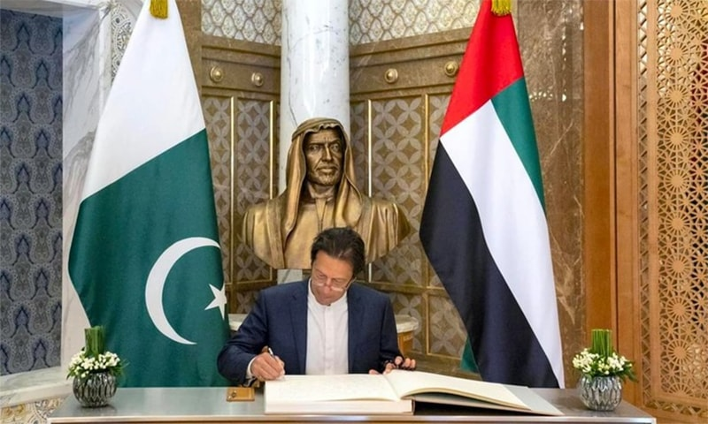 PM Imran Khan signs a guest book in Abu Dhabi during his one-day visit to the UAE in November. — Photo courtesy UAE Ministry of Presidential Affairs
